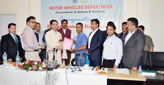 Transport Minister, Sunil Sharma, handing over temporary registration number to a customer during inauguration of Dealer Assisted Registration.