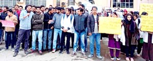 Dental College students protesting in Srinagar. -Excelsior/Shakeel
