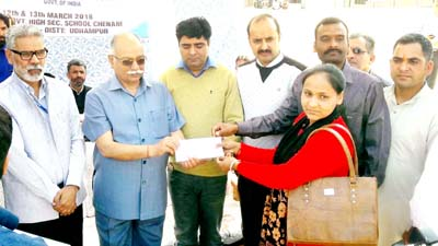 MLA, Chenani Dina Nath Bhagat handing over regularisation orders to ReT teachers on Tuesday.
