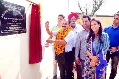 MLC, Ch Vikram Randhawa inaugurating class rooms of Pull Tawi High School on Tuesday.