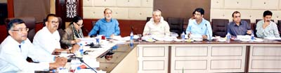 Industries Minister Chander Parkash Ganga chairing BoDs meeting of JKML at Jammu on Tuesday.