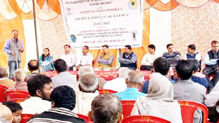SKUAST-J Scientist training farmers during awareness camp at Hiranagar on Wednesday.