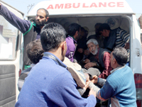 A civilian injured in South Kashmir being admitted in SMHS hospital, Srinagar on Sunday. —Excelsior/Shakeel