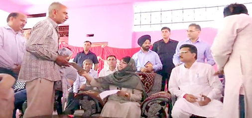 Chief Minister Mehbooba Mufti meeting border migrants in Samba on Friday.