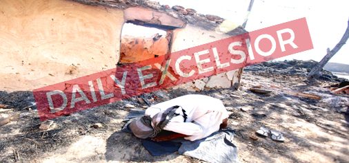 A Gujjar performs prayers during holy month of Ramzan at his 'Kullah' burnt in Pakistan shelling at Jeora Farm in RS Pura sector on Friday. -Excelsior/Rakesh