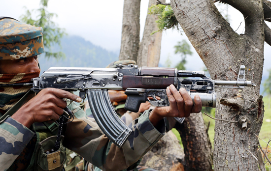 An Army jawan in action during encounter at Tanghdar area of Kupwara on Saturday. —Excelsior/Aabid Nabi