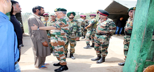 Army chief Gen Bipin Rawat with martyr Aurangzeb's father, Mohammad Hanief at Salani, Mendhar on Monday.