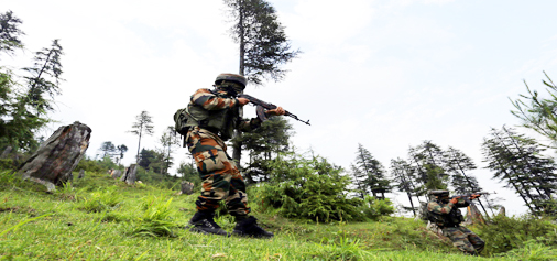 Army jawans in action during encounter in Panar area of Bandipora on Monday. -Excelsior/Aabid Nabi