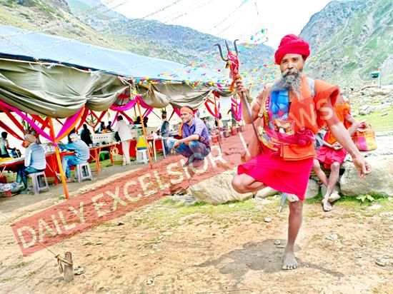 A Sadhu on way to holy cave walking on one leg at Naga Koti, Pahalgam on Tuesday.  -Excelsior/Sajjad Dar