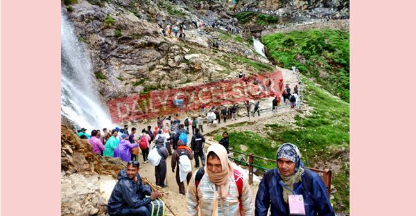 Yatris on way to holy cave via Pahalgam-Chandanwari track on Wednesday.  -Excelsior/Sajad Dar