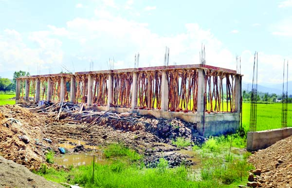 Illegal construction on agricultural land along newly constructed Handwara Bypass in North Kashmir. -Excelsior/Aabid Nabi