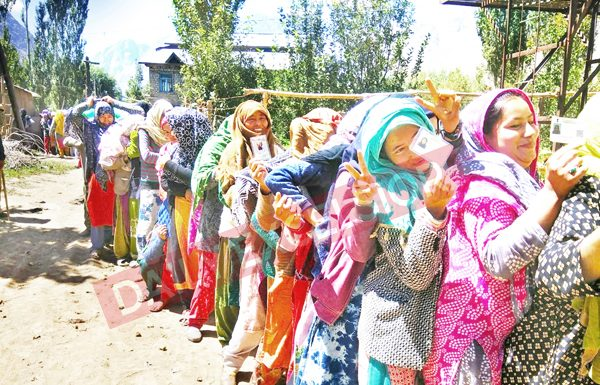 Women queue up to cast votes in a polling station at Kargil on Monday.