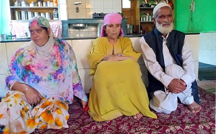 Family members of kidnapped cop, who was released on Friday, in their house at Arwani, Anantnag. -Excelsior/Sajad Dar