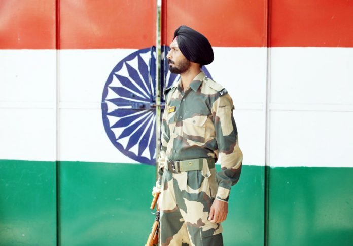 Indian Border Security Force solider stands guard at Suchategarh India-Pakistan international border. Excelsior/Rakesh