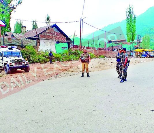 Troops at the site of encounter with militants at Kokernag in Anantnag on Friday. -Excelsior/Sajad Dar