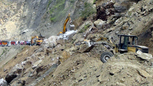 Machines engaged to clear National Highway near Ramban on Saturday.