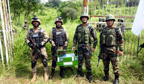 Indo-Pak troops exchange sweets at Chakan-Da-Bagh in Poonch on Tuesday.