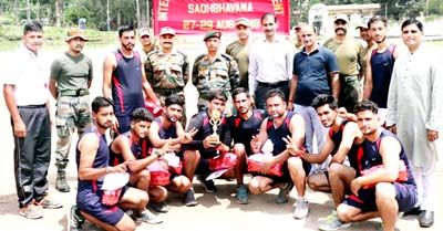 Winners of Volleyball Tournament organised by Army posing for a group photograph at Kalakote in Rajouri.