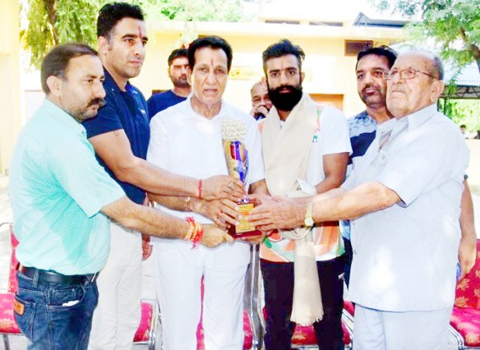 Former Minister and senior Congress leader honouring Surya Bhanu Partap Singh and Handoo in Akhnoor on Tuesday.