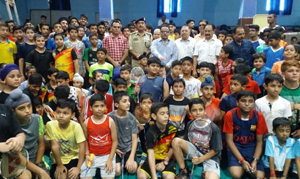 IGP Jammu Zone Dr SD Singh Jamwal, officials of Badminton Association and participating players posing for group photograph.