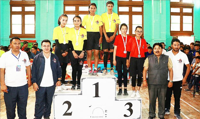 Medal winners posing along with officers and officials during Ladakh School Olympics in Leh.