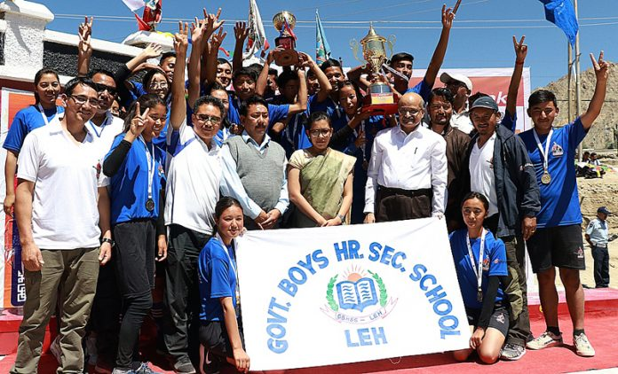 Winners of Ladakh School Olympics posing with Chief Secretary BVR Subrahmanyam during closing function of the event in Leh.