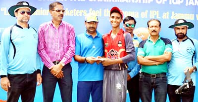 Mohd Aman receiving man of the match award from former Member BCCI and Working Committee Member JKCA Ankush Abrol at KC Sports Club in Jammu.