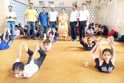 Players performing Yoga during Inter-District competition in Jammu.