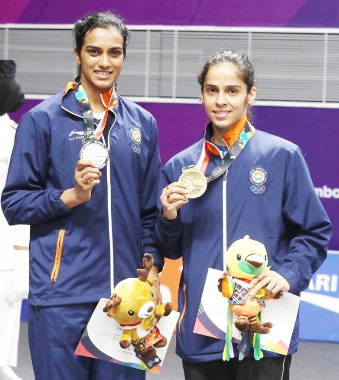 India's Star Shuttlers P V Sindhu and Saina Nehwal displaying medals at Jakarta.