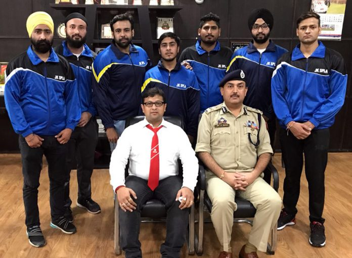 State Powerlifting men's Equipped team posing for a group photograph along with IGP Jammu, Dr SD Singh on Friday.