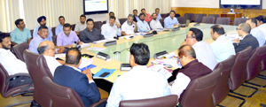 Chief Secretary chairing a meeting at Srinagar on Thursday.