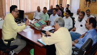 Principal Secretary Finance, Navin K Choudhary chairing a meeting in Srinagar on Thursday.