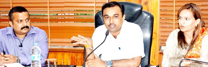 DC Ramesh Kumar chairing a meeting in Jammu on Monday.