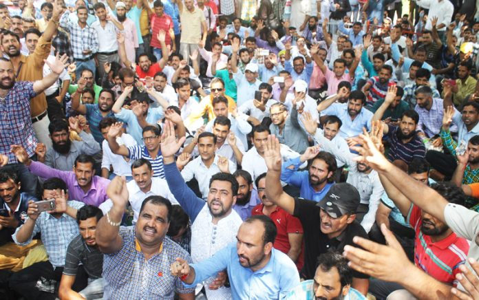 ReT teachers raising slogans during a sit in protest at Jammu on Tuesday. -Excelsior/ Rakesh