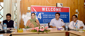 DC Budgam Dr Syed Sehrish Asgar and others during 64th DLRC/DCC meeting.