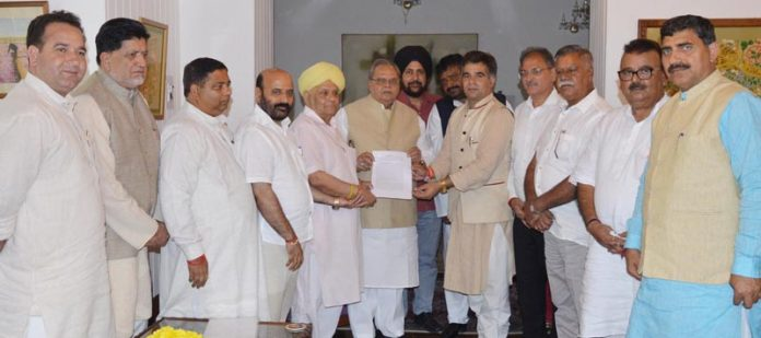 BJP delegation meeting Governor Satya Pal Malik in Srinagar on Friday.