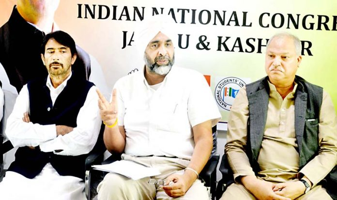 Manpreet Badal, Finance Minister of Punjab along with senior Congress leaders of J&K addressing a press conference at Congress headquarters in Srinagar on Wednesday. -Excelsior/Shakeel