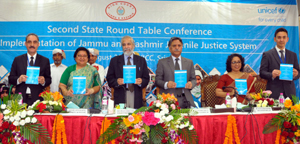 Supreme Court and J&K High Court Judge and others during a conference in Srinagar on Saturday.
