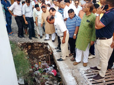 MLA Sat Sharma alongwith officials inspecting a damaged drain in Ward 35, Janipur on Sunday.