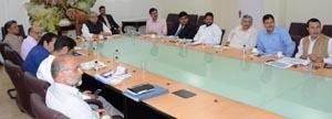 Governor S P Malik chairing a meeting at Civil Secretariat Srinagar on Thursday.