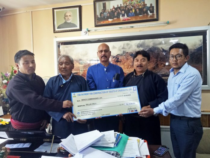 Regional Director, BPCL, Rajesh Sharma handing over a cheque of Rs 10 lakh to Dorjay Motup, CEC LAHDC in the presence of Executive Councilors.
