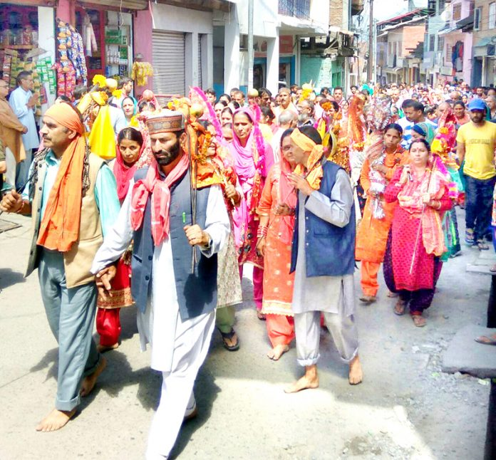 Pilgrims leaving for Mani Mahesh Shrine from Bhadarwah on Wednesday. — Excelsior/Tilak Raj