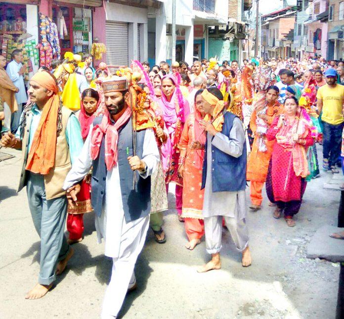 Pilgrims leaving for Mani Mahesh Shrine from Bhadarwah on Wednesday. — Excelsior/Tilak Raj