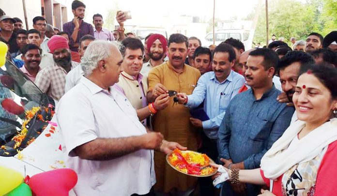 MP Jugal Kishore Sharma handing over keys of ambulance to villagers of Balshama in Nowshera.