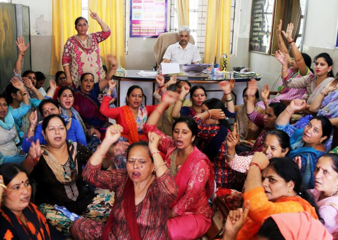 Female Multipurpose Health Workers staging protest in office chamber of Deputy CMO Jammu.