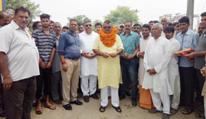 Former Minister and MLA, C P Ganga kick starting work on road project on Thursday. —Excelsior/Gautam