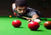 Cueist aiming at target during Six Red Balls Tournament at Billiards Hall, MA Stadium in Jammu. —Excelsior/Rakesh