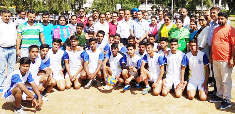 Winners of Divisional Level Inter-District Volleyball Tournament posing for group photograph at Udhampur.