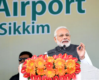 Prime Minister, Narendra Modi addressing the gathering at the inauguration of the Pakyong Airport, in Gangtok, Sikkim on Monday.