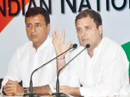 Congress President Rahul Gandhi with party spokesperson Randeep Surjewala addressing a press conference on Rafale deal issue, at AICC headquarters, in New Delhi on Saturday. (UNI)
